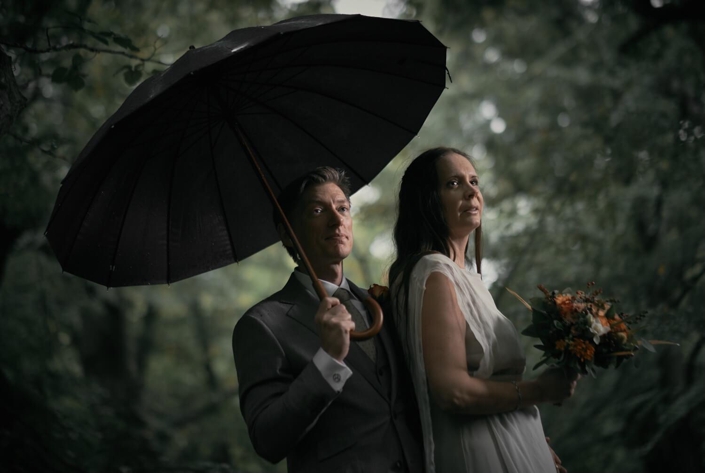 Eva, beautiful real bride under the rain in a Larimeloom wedding dress