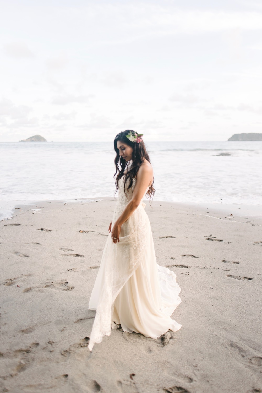 Tropical beach wedding in a beaded wedding dress
