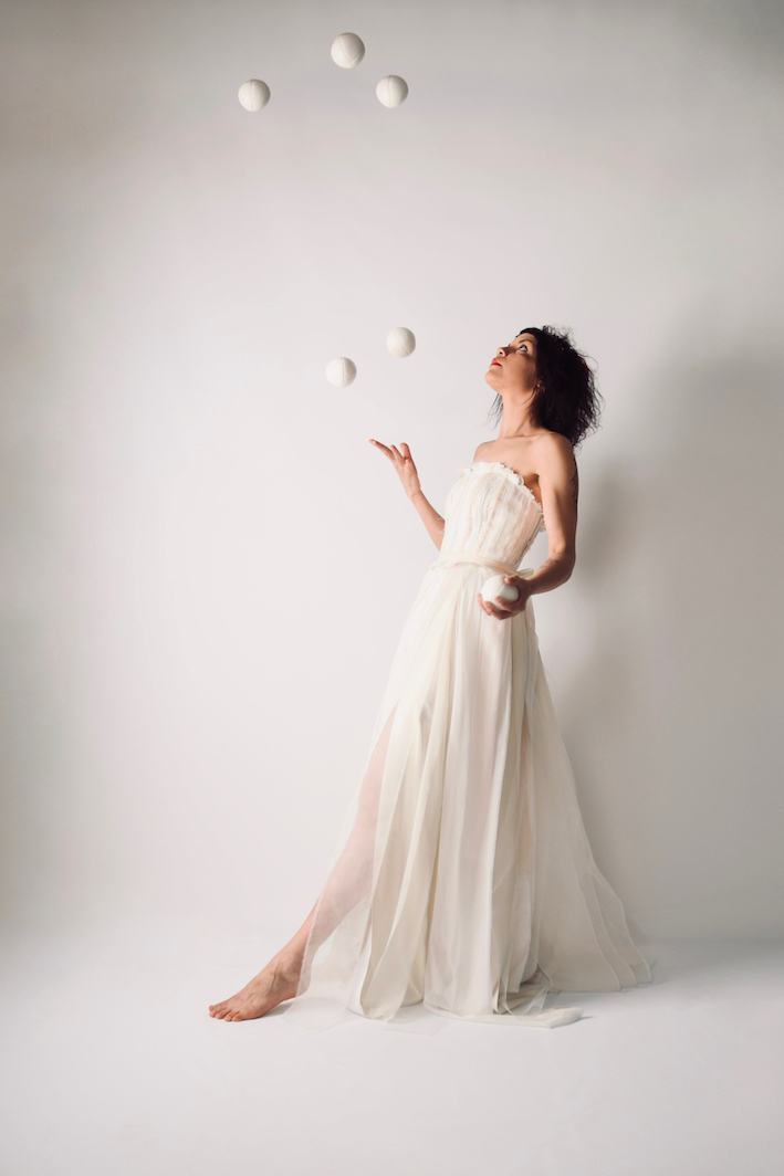 Francesca Mari Juggling wearing Larimeloom wedding dress