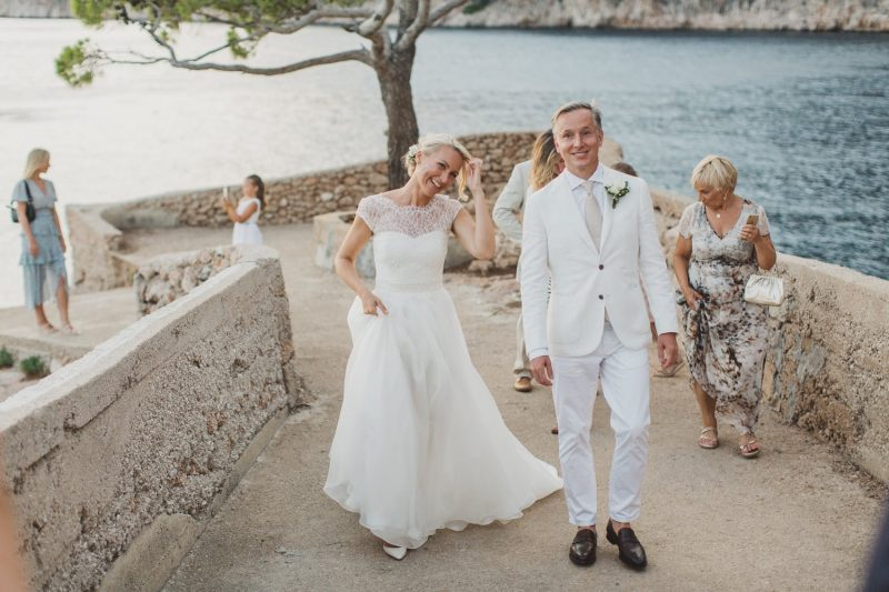 destination wedding in greece wearing romantic wedding dress in silk and lace, beach wedding real bride